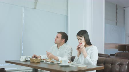 quarreling : Young couple not liking their food and asking waiter to take it away