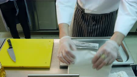 top chef : Chef wrapping fresh fish in napkins Stock Footage