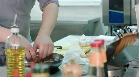 tempura : Chefs male hands putting royal shrimps on a frying pan Stock Footage