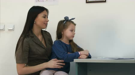 self examination : Young mother proud of her little girl and doctor giving her a lollipop after the exam Stock Footage
