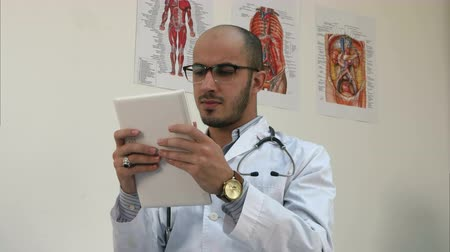 touching screen : Concentrated male medical worker using digital tablet
