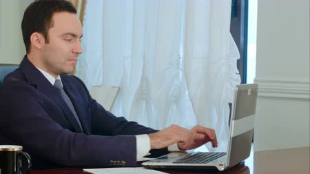 detailing : Office hard job businessman calculate contract, talking and using laptop Stock Footage