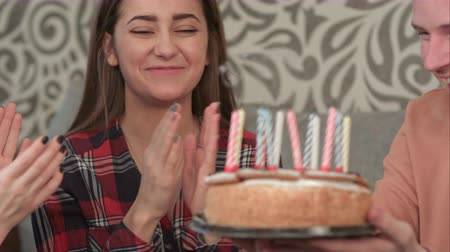 veselí : Happy girl at her birthday makes a wish and blows out the candles on the cake