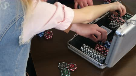 žolík : Male hands take cards and chips from the poker case on the table