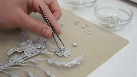 yosma : Master takes diamond in tweezers and puts it on the jewellery