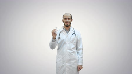 antykoncepcja : Young doctor presenting brand new medicine on white background. Wideo