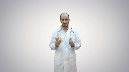 antykoncepcja : Doctor explaining difference between the pills on white background.