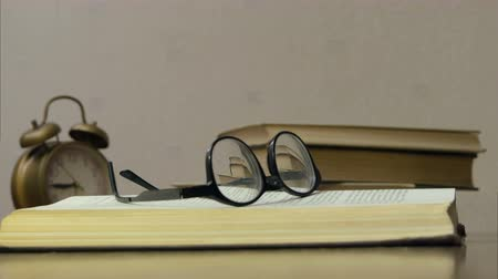 ansiklopedi : Reading glasses laying on the opened book