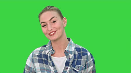 feminino : Cheerful young woman talking to a camera on a Green Screen, Chroma Key. Vídeos