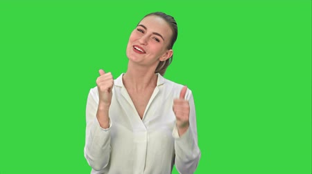 tank top : Happy excited woman showing approval hand gesture thumb up and smiling on a Green Screen, Chroma Key.