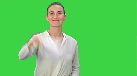 восстание : Young pretty businsswoman throws paper document pages on a Green Screen, Chroma Key.