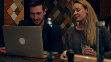 cheers : A couple have video chat via laptop with friends in a restaurant Stock Footage