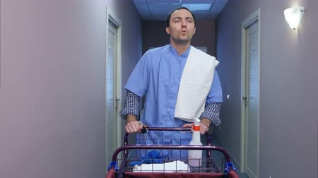 affiliate : Young housekeeping worker offering cleaning services for hotel guests Stock Footage