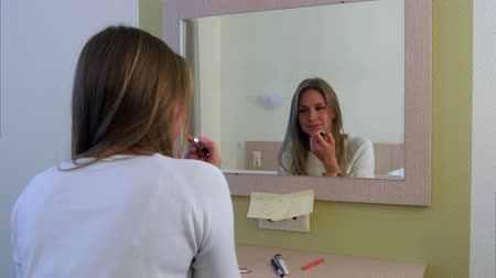 rouge : Morning routine of girl applying make-up before going to a meeting Stock Footage
