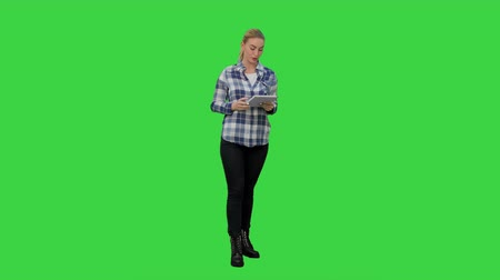 news stand : Young woman using reading presentation from a tablet on a Green Screen, Chroma Key.