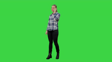 exited : Happy young woman talking on mobile phone smiling on a Green Screen, Chroma Key.