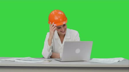 chroma key background : Female construction specialist in hardhat have online video chat with friend on a Green Screen, Chroma Key.