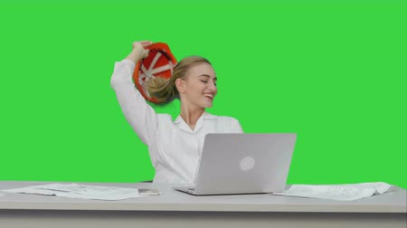 exited : Female chief engineer celebrate a successful finish of project, smiling on a Green Screen, Chroma Key.