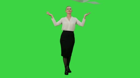riot : Happy businesswoman throws paper document pages and smiling on a Green Screen, Chroma Key. Stock Footage