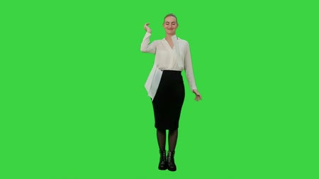 exited : Young pretty woman throw papers finishing work successfully on a Green Screen, Chroma Key.