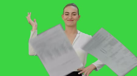 holding document : Happy confident woman throw papers on a Green Screen, Chroma Key. Stock Footage