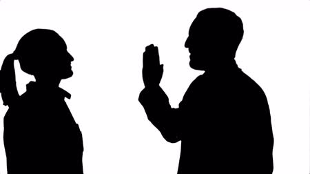 girl claps : Silhouette Young doctor joking on his collegue not give five.