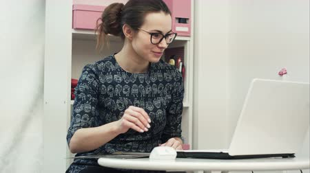 organizing : Happy young designer consult and offer new clothes to a forein customer having online conference with a laptop computer Stock Footage