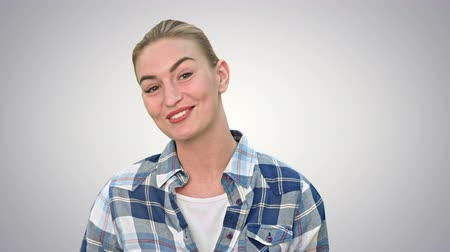 продавщица : Cheerful young woman talking to a camera on white background.