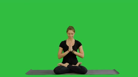 restorative : Sporty attractive woman practicing yoga, sitting in Full Lotus exercise, Siddhasana pose, working out on a Green Screen, Chroma Key