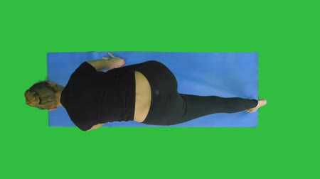 fulllength : Healthy yoga woman does stretch on mat on a Green Screen, Chroma Key Stock Footage