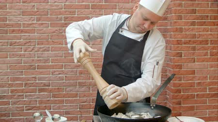 wok food : Chef putting salt and pepper to the pan for cooking seafood Stock Footage