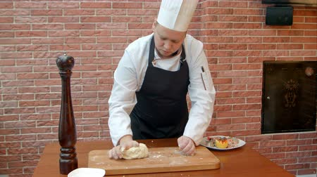 bread stick : Chef kneading a dough Stock Footage
