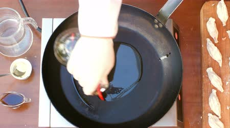 olive oil pour : Pouring olive oil over a pan Stock Footage