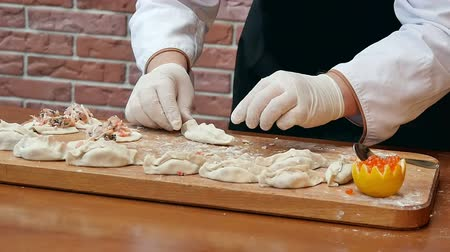 клецка : Making dumplings with seafood on wooden board