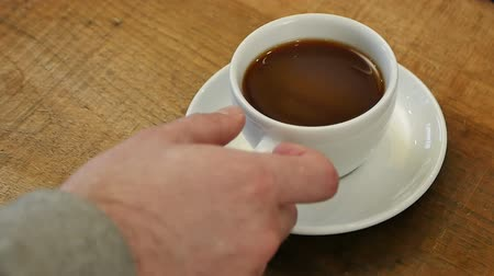 caneca : Male hand take a cup of coffee Stock Footage
