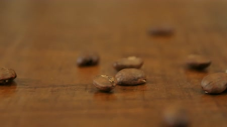cheerfulness : Coffee beans on wooden table Stock Footage