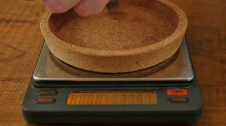weighing machine : Barista weighs the roasted coffee beans