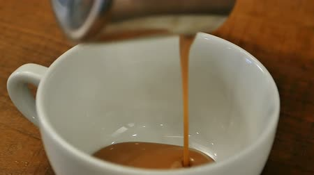 high calories : Pouring sweet caramel syrop for coffee