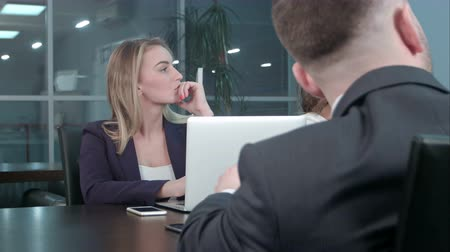 conference table : Young blond businesswoman working communicate with colleagues at conference in the office