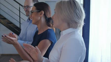 listener : Happy group of business people clapping in office Stock Footage