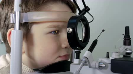 field measurements : Optometrist performing visual field test of young boy