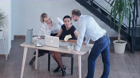 notion : Group of happy diverse male and female business people in formal gathered around laptop computer in bright office Stock Footage