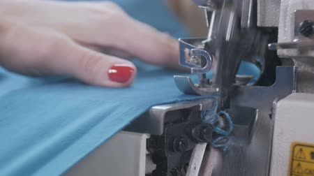 paplan : A quilter stitches cut pieces of colorful fabric for a quilt top