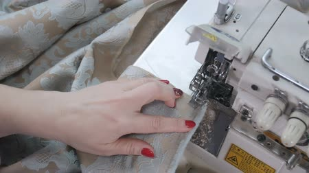 miktar : Tailor using a cutter for cutting fabrics Stok Video