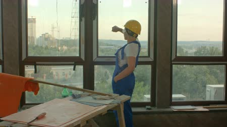 looking distance : Young worker on construction site looking at city Stock Footage