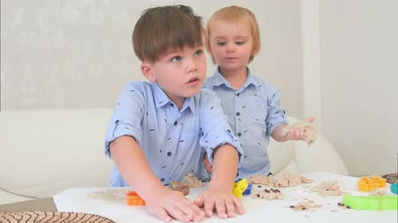 hoe : Two little boys playing with dough and learning how to bake