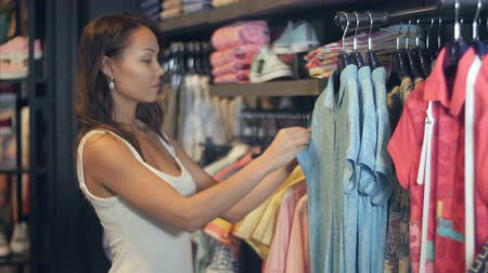 Beautiful businesswoman buying clothes Stok Video
