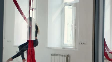 Beautiful pole dancer have a workout with aerial silk in studio Stok Video