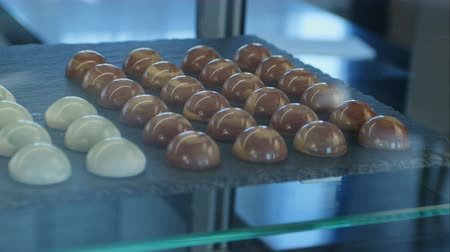 Chocolate and white chocolate candies in shop window