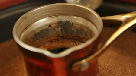 kafeterya : Traditional process boil Turkish coffee in turk Stok Video